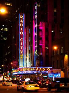Radio City Music Hall and Yellow Cab by Night, Manhattan, Times Square, New York City, US, USA by Philippe Hugonnard