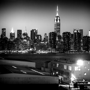 Skyline of the Skyscrapers of Manhattan by Night from Brooklyn by Philippe Hugonnard