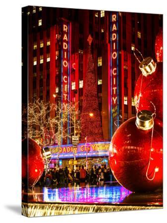 The Giant Christmas Ornaments on Sixth Avenue across from the Radio City Music Hall by Night