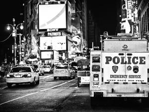Yellow Cabs and Police Truck at Times Square by Night, Manhattan, New York by Philippe Hugonnard