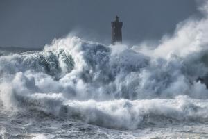 Bretagne Ocean Waves over the Lighthouse by Philippe Manguin