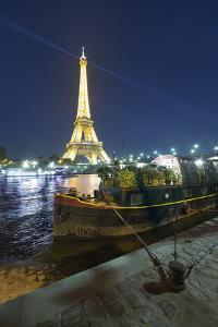 Eiffel tower in Paris and Seine chanel by night by Philippe Manguin