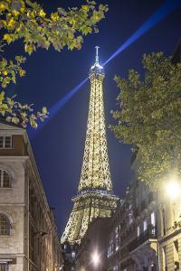 Eiffel tower in Paris street by night by Philippe Manguin