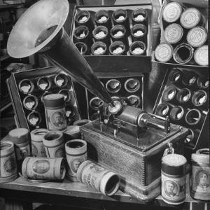 Phonograph Invented by Thomas A. Edison Sitting on Table with Boxes of Cylindrical Records