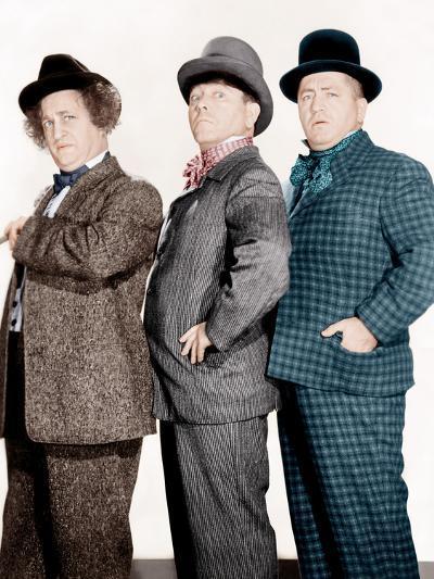 PHONY EXPRESS, from left: Larry Fine, Moe Howard, Curly Howard, (aka The Three Stooges), 1943--Photo