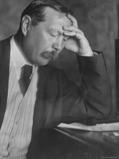 Photo by E. O. Hoppe of Author Sir Arthur Conan Doyle Seated, Eyes Downcast, in Reflective Pose-Emil Otto Hopp?-Premium Photographic Print
