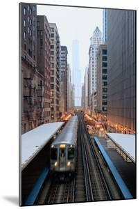 Elevated Commuter Train in Chicago Loop by Photo by John Crouch