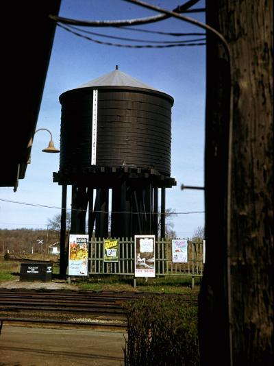 Photo Taken from Window of a Train Showing Water Storage Tower Beside Tracks-Walker Evans-Photographic Print