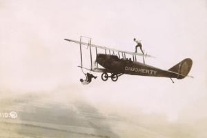 Photograph of a Wingwalkers on a Biplane