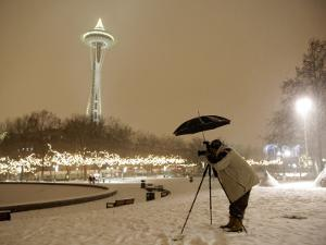 Photographer Anthony Evora Uses an Umbrella to Keep Falling Snow Off of His Camera, in Seattle