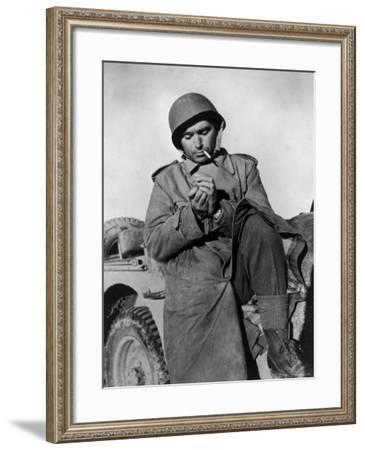 Photographer Robert Capa Pausing for a Smoke While on Duty at the Tunisian Front--Framed Premium Photographic Print