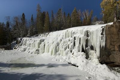 Frozen Gooseberry Falls along Lake Superiors Northern Shore.