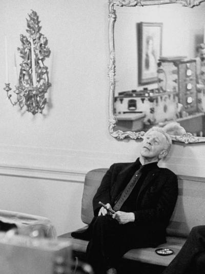 Pianist Artur Rubinstein Sitting on Couch and Holding Cigar During Restful Moment--Premium Photographic Print