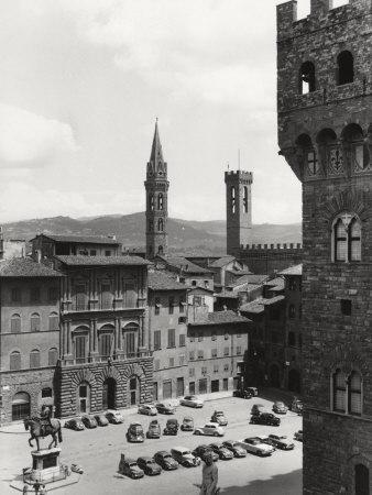 https://imgc.artprintimages.com/img/print/piazza-della-signoria-in-florence-with-the-belltower-of-the-badia-fiorentina-and-the-bargello-tower_u-l-q10szlz0.jpg?p=0