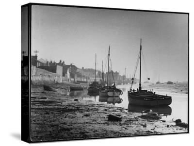 Picturesque Scene Showing Boats Reflected in the Water Next to the Mudflats of the Thames Estuary