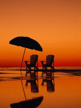 https://imgc.artprintimages.com/img/print/picturesque-scene-with-two-chairs-and-an-umbrella-on-the-beach_u-l-p8i8lk0.jpg?p=0