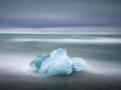 Piece of Glacial Ice Washed Ashore By the Incoming Tide Near Glacial Lagoon at Jokulsarlon, Iceland-Lee Frost-Photographic Print
