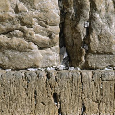 Pieces of Paper with Written Prayers Placed in the Wailing Wall by Pious Jews