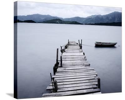 Pier and Boat on Lake--Stretched Canvas Print