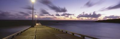 Pier and Coastline Just before Dawn-Design Pics Inc-Photographic Print