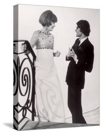 Fashion Designer Yves Saint Laurent Talking with Client Mrs. Stanley Donen at His Boutique
