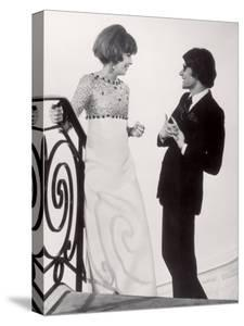 Fashion Designer Yves Saint Laurent Talking with Client Mrs. Stanley Donen at His Boutique by Pierre Boulat