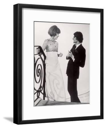 Fashion Designer Yves Saint Laurent Talking with Client Mrs. Stanley Donen at His Boutique
