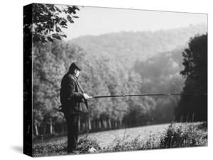 Fisherman on Banks of European Waterway by Pierre Boulat