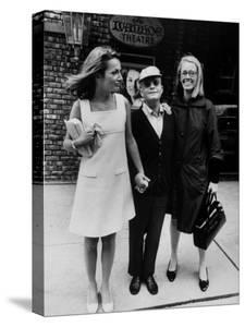Lee Radziwill, Truman Capote, and Jane Howard Walking Arm in Arm While Leaving the Ivanhoe Theater by Pierre Boulat