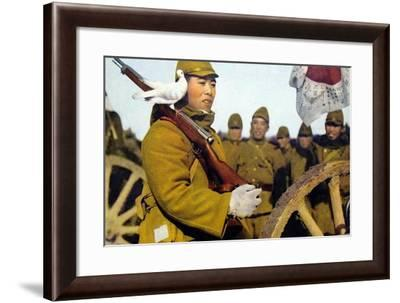 Pigeon Rests On A Japanese Infantryman's Rifle As He Marches--Framed Art Print