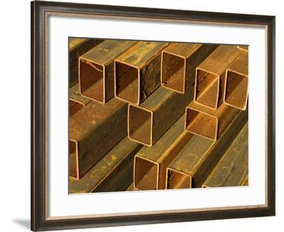 Pile of Rustic Metal Pipes--Framed Photographic Print