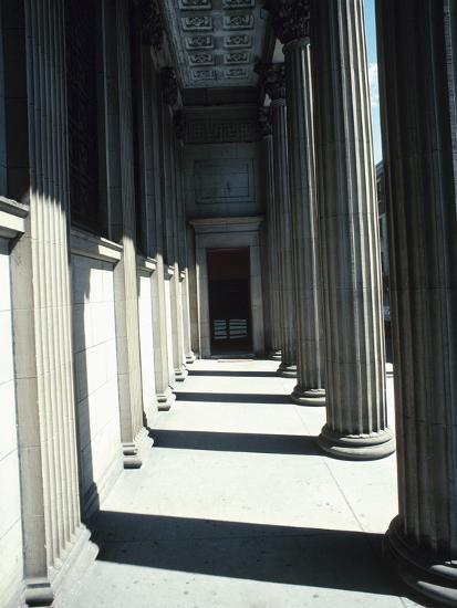 Pillar Lined Walkway - Architecture Montreal--Photographic Print