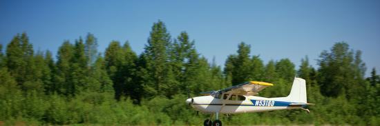 Pilot Taking Off from Goose Bay Gravel Strip in a Cessna 180 Taildragger, Alaska, USA-Paul Andrew Lawrence-Photographic Print