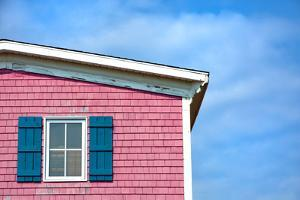 Architecture Detail of a Pink House with Blue Shuttered Window against Blue Sky by pink candy