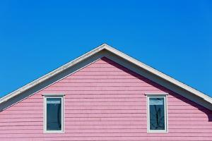 Detail of a Pink Rooftop in Iles De La Madeleine in Canada by pink candy