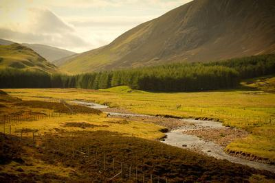 River with Mountains around the Cairngorms, Scotland, Uk.
