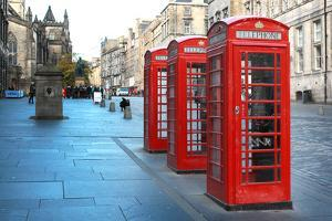 Three Red Booths on a Row in the Street on Edinburgh, Scotland, Uk. by pink candy