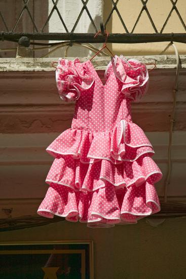 Pink flamenco dress for little girl hangs in Centro old district of Sevilla Spain--Photographic Print