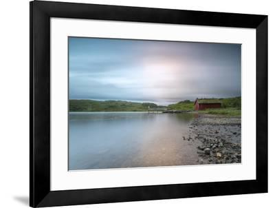 Pink lights of the midnight sun illuminate sea and the typical rorbu, Holdalsvatnet, Vestvagoy, Lof-Roberto Moiola-Framed Photographic Print