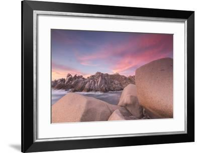 Pink sky at sunset frames the lighthouse on cliffs, Capo Testa, Santa Teresa di Gallura, Italy-Roberto Moiola-Framed Photographic Print