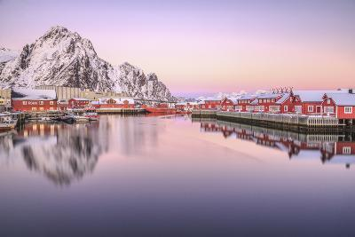 Pink Sunset over the Typical Red Houses Reflected in the Sea. Svollvaer, Lofoten Islands, Norway-ClickAlps-Photographic Print