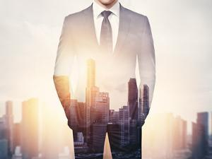 Double Exposure of Businessman and City by pinkypills