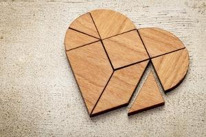 Heart Version of Tangram, a Traditional Chinese Puzzle Game Made of Different Wood Parts to Build A by PixelsAway