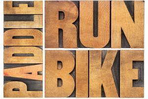 Run, Bike,  Paddle - Triathlon or Recreation Concept - Isolated Word Abstract in Vintage Letterpres by PixelsAway