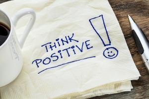 Think Positive - Motivational Slogan on a Napkin with a Cup of Coffee by PixelsAway