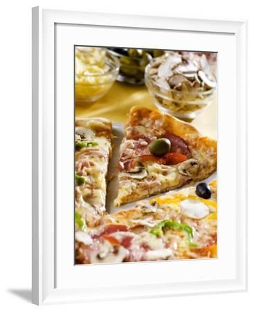 Pizza with a Slice Cut and Pizza Ingredients--Framed Photographic Print