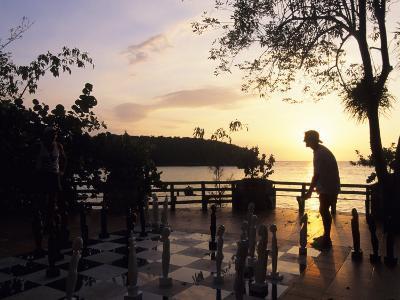 Playing Floor Chess at Sunset at Grand Lido Sans Souci Resort, Ocho Rios, Jamaica-Holger Leue-Photographic Print