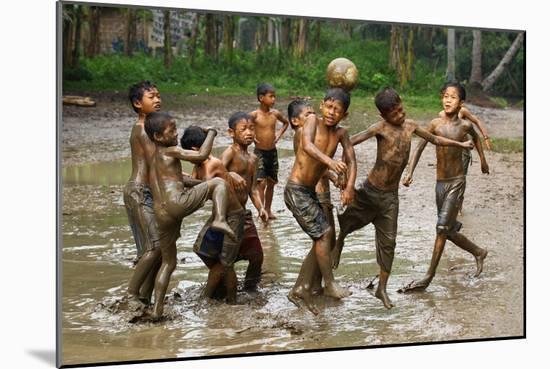 Playing Football-Angela Muliani Hartojo-Mounted Photographic Print