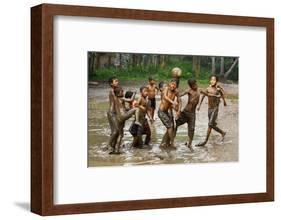 Playing Football-Angela Muliani Hartojo-Framed Photographic Print