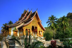 Buddhist Temple in Luang Prabang Royal Palace, Laos by PlusONE